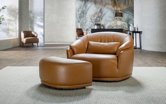 Amos leather swivel armchair in beige